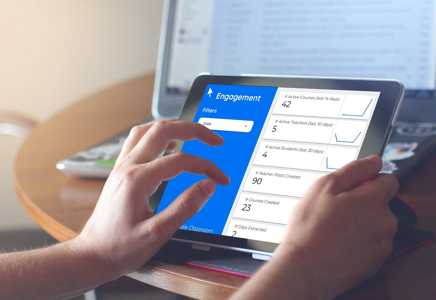 Person using education dashboard on tablet